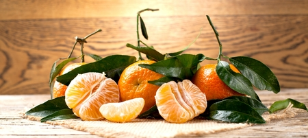 Fresh picked mandarins on wooden background closeup Stock Photo