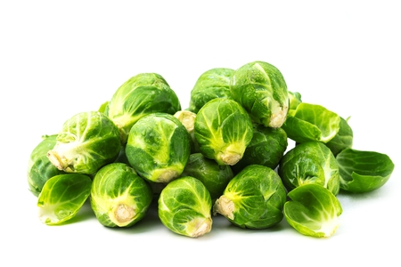 Fresh Bruxelles sprouts on white background closeup