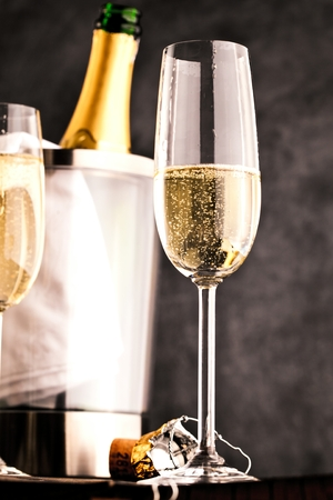 champagne glasses and bottle on dark background
