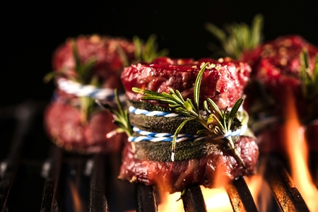 Fresh fillet steak on Grill with flammes