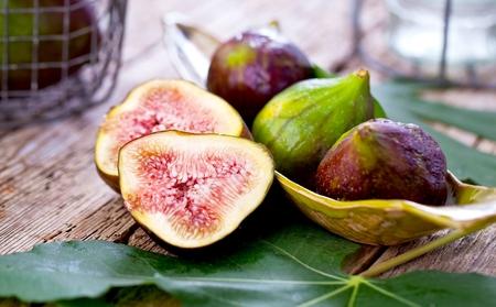 Freshly cut Fig Fruit on wooden background. Archivio Fotografico