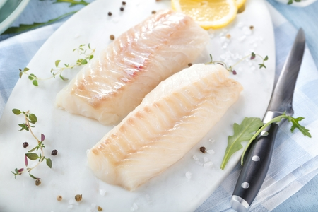 Fresh fish, raw cod fillets with addition of herbs and lemon Stock fotó