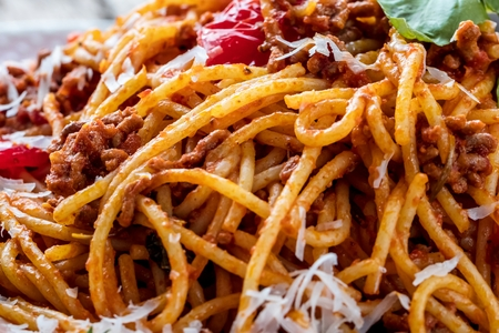 Fresh and delicious spagetti bolognese on wooden table