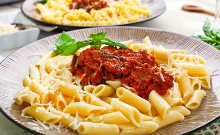 Pasta Penne with Tomato Bolognese Sauce, Parmesan Cheese and Basil