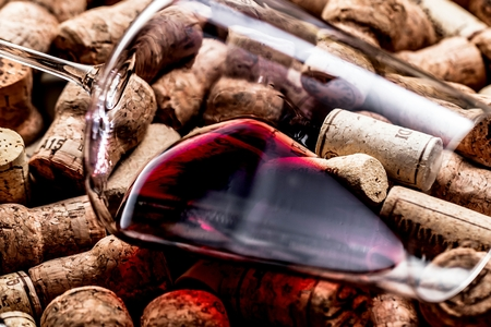 Wine corks background red wine glass and wine corks