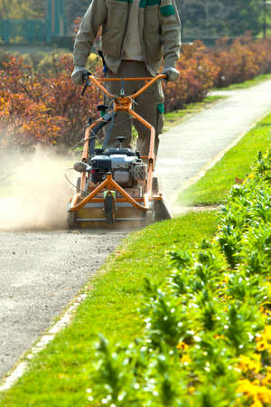 Process of lawn mowing, concept of mowing the lawn, lawnmower cutting grass with gardening tools.