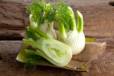 Fresh Florence fennel bulbs or Fennel bulb on wooden background. Healthy and benefits of Florence fennel bulbs Imagens
