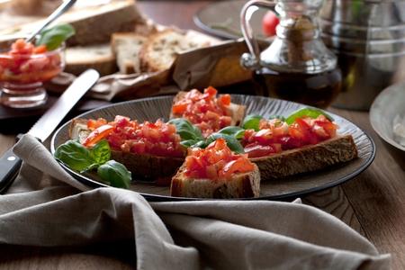 Italian cooking concept. Bruschettas with pesto, tomatoes