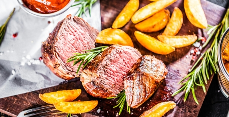 Healthy lean grilled medium-rare beef steak and vegetables with roasted Potatoes
