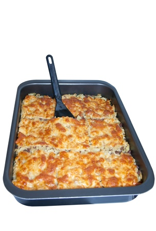 Pasta with minced meat and cheese baked in a pan  Isolation on white Stock Photo - 16291271