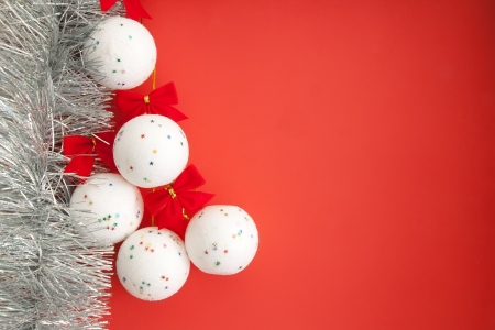 christmas paste: Christmas decorations  White balls on a red background, with copy paste space