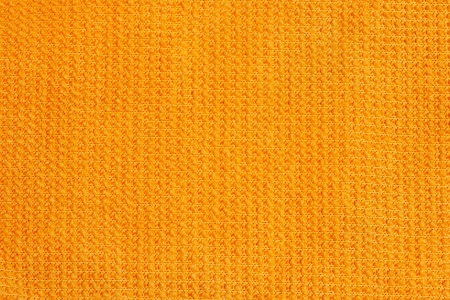 Abstract background. Orange micro fiber cloth. Close up. photo