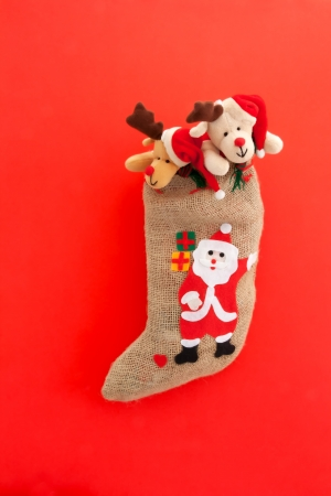 Christmas stocking with Santa Claus  On red background  photo