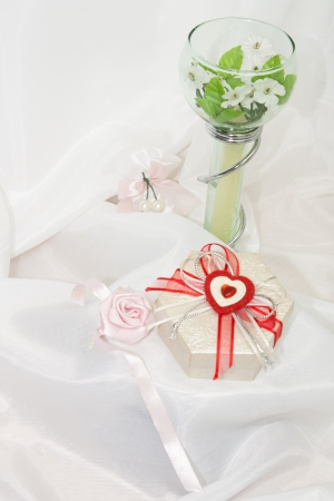 beloved: Gifts for the beloved  White satin background  Stock Photo
