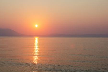 Beautiful sunset in Aegean sea  Sunrise at Strimonikos gulf, New Vrasna, Greece photo
