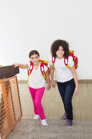 Ten year old twin sisters go to school photo