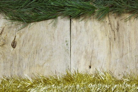 christmas paste: Christmas  Pine branch and ornaments on a wooden plank, with paste space