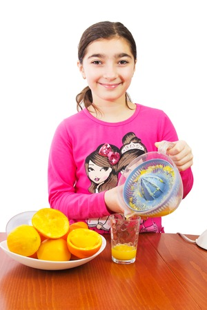 Young girl making fresh orange and lemon juice photo