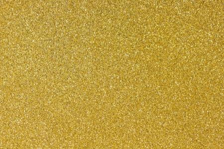Hintergrund mit glänzenden Gold-Glitter gefüllt Standard-Bild