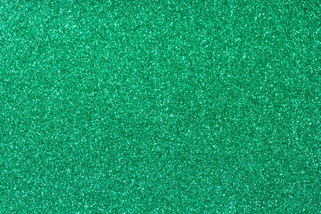 Background filled with shiny green glitter photo