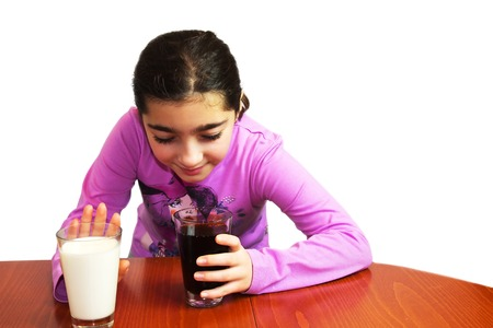 chose: Dilemma - milk or cola. The young girl easy chose. Isolated on white. Stock Photo