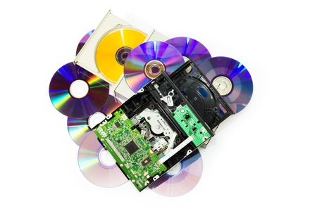 Electronic waste. Broken CD and DVD players. On white . photo