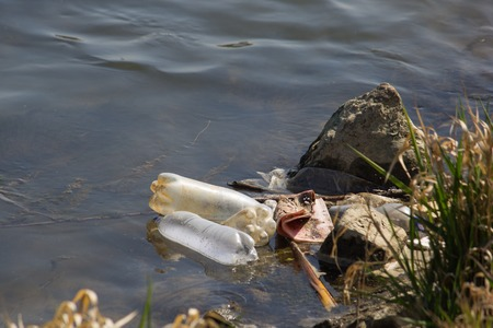 Detail of Polluted River with Trash. Eco Disaster.