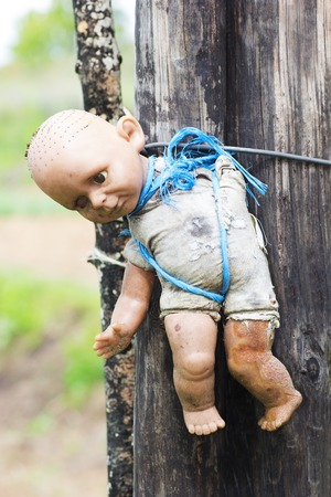 Damaged Old Doll. Concept: Abuse and Mistreatment of Children. photo