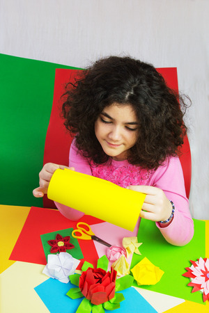 Ten Year Old Girl with Decorations and Colorful Paper. photo
