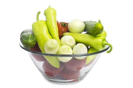 Fresh vegetables in a Glass Bowl Isolated on White. Organic Food. photo