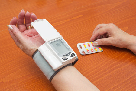 Blood Pressure Meter on Adult Woman Wrist. photo