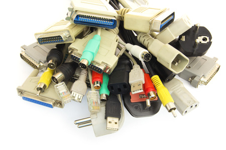 adapters: Old Connecting Cables and Adapters on White .