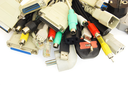 e waste: Bunch of Computer Cables with Sockets on White Background. Stock Photo