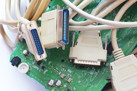 e waste: Old Connecting Cables and Adapters on White Background.