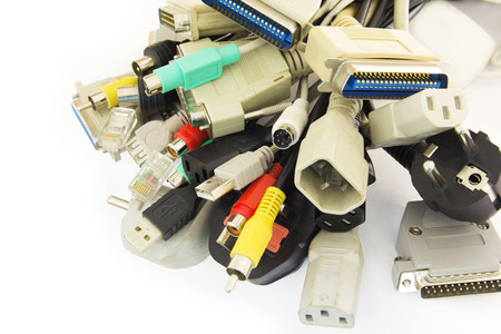 Old Connecting Cables and Adapters on White Background. photo