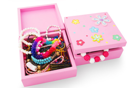 Jewelry and Bracelets in the Box Isolated on White. Young Fashion Concept. photo