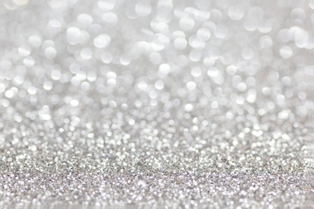 Silver Glitter for Christmas Background with Blurred Lights.