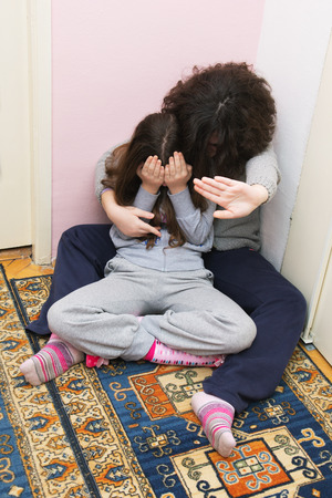 Two Young Sisters Crying. Concept: Domestic and Family Violence. Abuse Child. photo