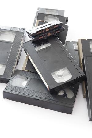 videocassette: Viejo VHS de v�deo y audio casetes Aislado en un fondo blanco. Foto de archivo