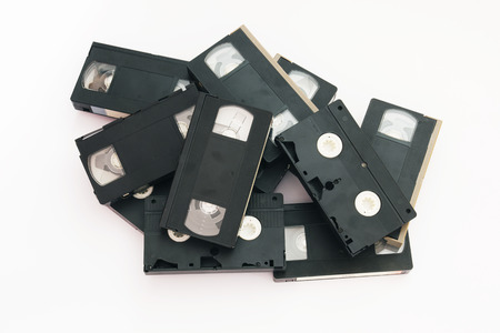 Old VHS Video Cassettes Isolated on a White Background. photo