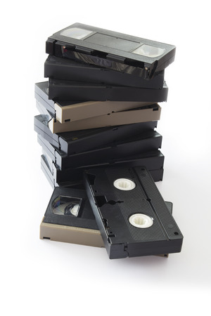 Pile of Old VHS Video Cassettes Isolated on a White Background.
