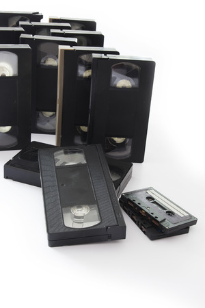 videocassette: Old VHS Video and Audio Cassettes Isolated on a White Background. Stock Photo