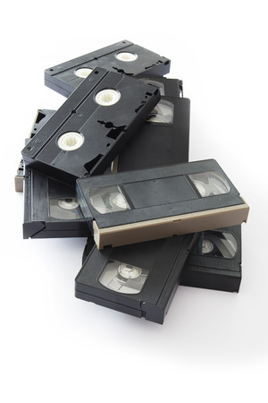 videocassette: Pile of Old VHS Video Cassettes Isolated on a White Background.