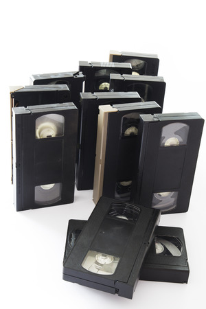 Old Video Cassettes Isolated on a White Background. photo