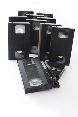videocassette: Antiguo vídeo y audio casetes Aislado en un fondo blanco.