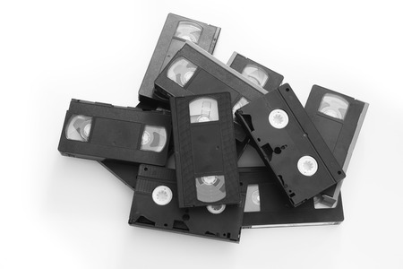 Pile of Old Video Cassettes Isolated on a White Background. photo