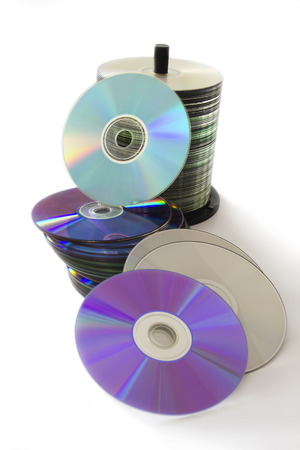 Stack of CD and DVD Discs Isolated on White Background. photo