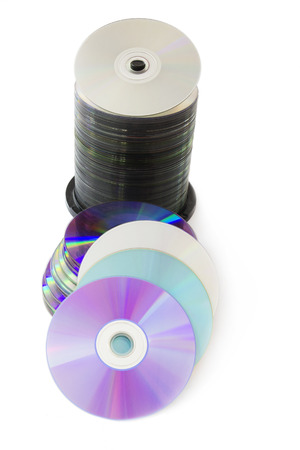 Lots of CD and DVD Discs Isolated on White Background. photo