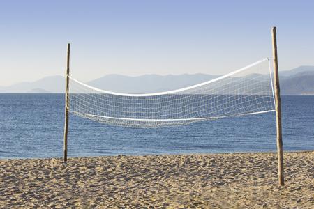A Beach Volleyball Net on an Empty Beach. photo