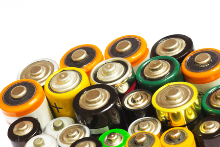 aaa: Group of Old AA and AAA Batteries in Closeup on White. Selective Focus.